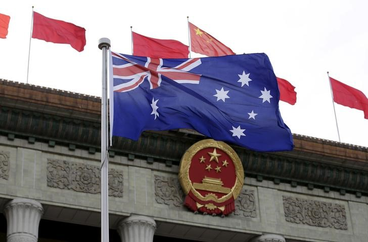 Australia's flag flutters in front of the Great Hall of the People during a welcoming ceremony for Australian Prime Minister Malcolm Turnbull (not in picture) in Beijing, China, April 14, 2016. Photo: Reuters/Jason Lee
