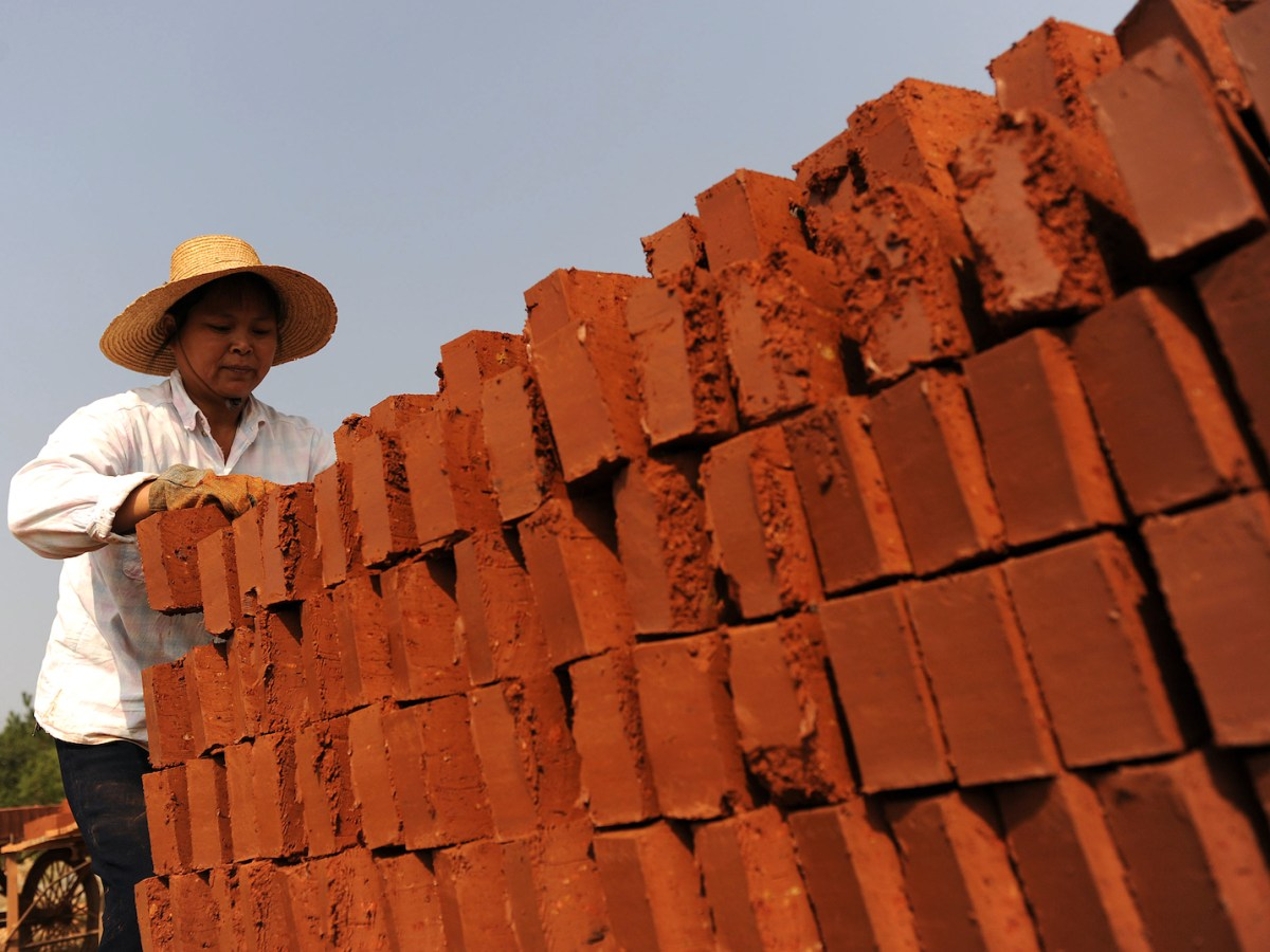 A Chinese laborer at a brick factory in China. Photo: AFP