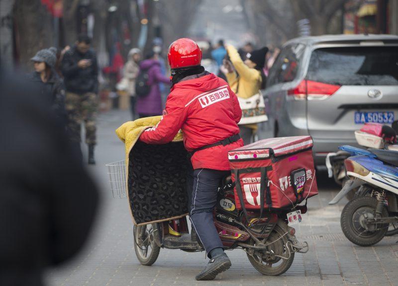 电單车和电單车送货司机是北京景观的一部分。 相片:iStock