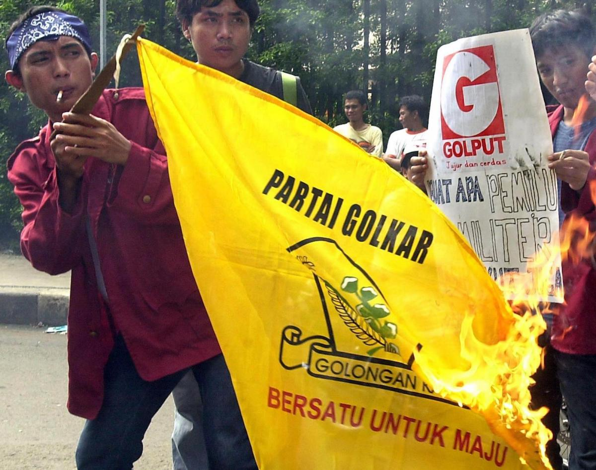 Indonesian students burn a  Golkar party flag in front of their campus in Jakarta in a file photo. Photo: AFP/Choo Youn-Kong