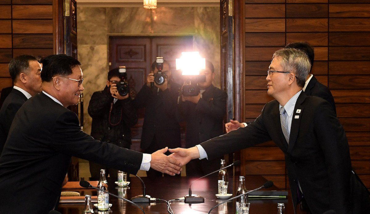 Kwon Hyok-bong, director of the Arts and Performance Bureau in North Korea's Culture Ministry, shakes hands with Lee Woo-sung, head of the culture and arts policy office at the Culture Ministry, during their meeting in the truce village of Panmunjom, North Korea, on January 15, 2018. Photo: The Unification Ministry / Yonhap via Reuters
