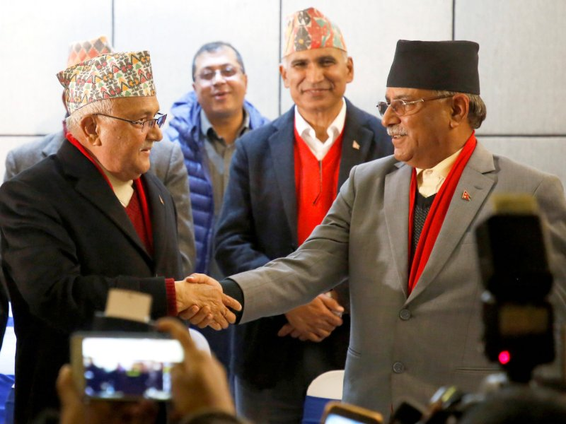 CPN-UML chairman Khadga Prasad Sharma Oli (left) shakes hands with the chairman of the Communist Party of Nepal (Maoist Centre), Pushpa Kamal Dahal, aka Prachanda, during a news conference in Kathmandu on December 17, 2017.  Photo: Reuters / Navesh Chitrakar