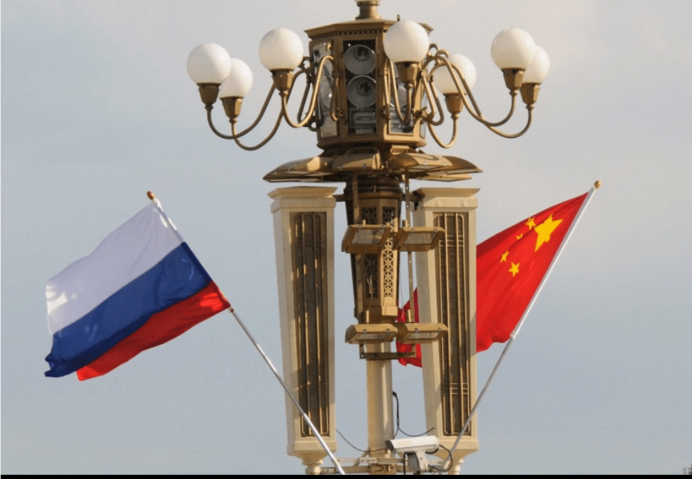 A file photo shows Russian and Chinese flags in Tiananmen Square in Beijing. Photo: Xinhua