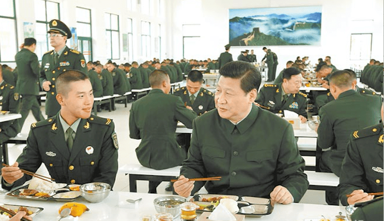 Chinese President Xi Jinping, also the top commander of the Chinese military, dines with frontline soldiers. Photo: PLA Daily