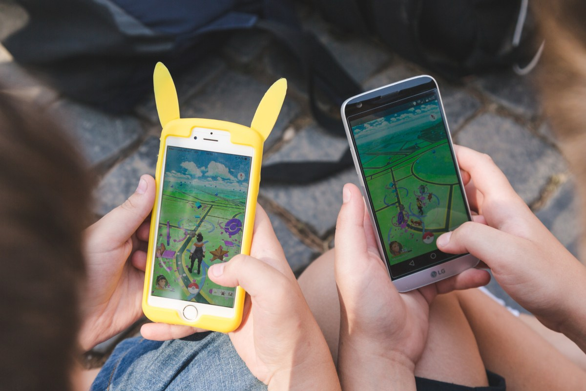 A crowd composed by young and adult plays the Pokemon Go game on mobile phones, during a big gathering self organized by the players. Photo: iStock