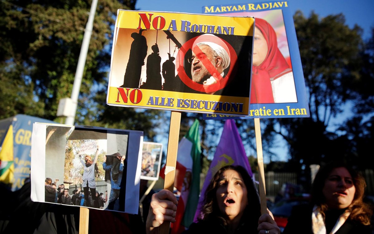 Opponents of Iranian President Hassan Rouhani hold a protest outside the Iranian embassy in Rome on January 2, 2018. Photo: Reuters / Tony Gentile.