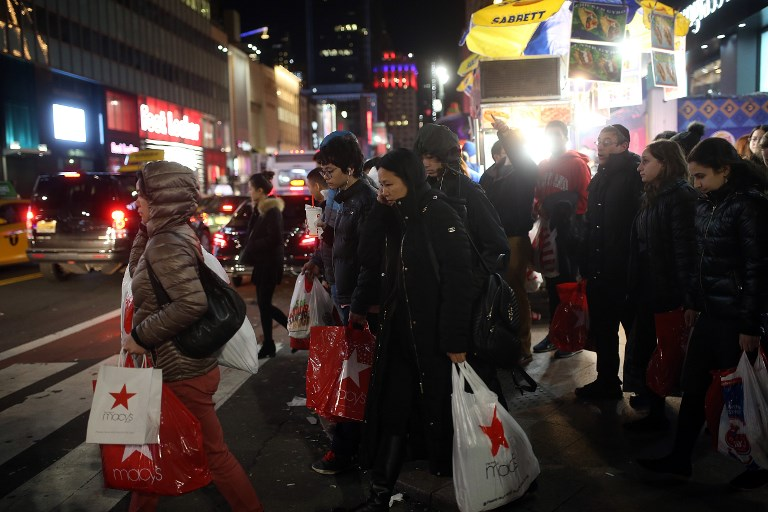 Shoppers seen in Midtown Manhattan, New York. Photo: AFP
