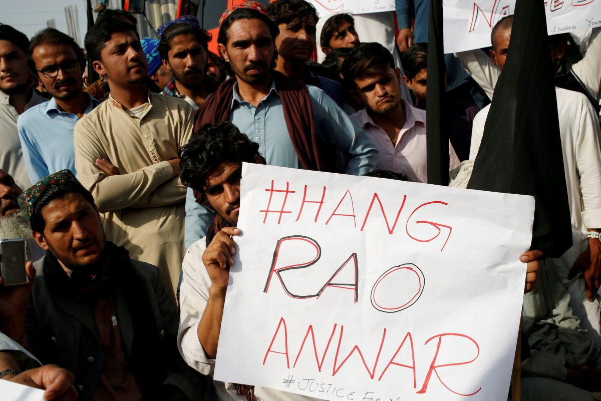 """People hold sign as they gather to condemn the death of Naqibullah Mehsud, whose family said was killed by police in a so-called """"encounter killing"""", during a grand jirga (tribal assembly or public meeting) in Karachi, Pakistan January 22, 2018. Photo: Reuters"""