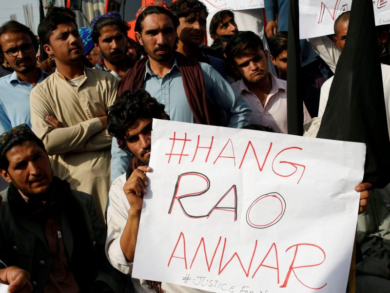 "People hold sign as they gather to condemn the death of Naqibullah Mehsud, whose family said was killed by police in a so-called ""encounter killing"", during a grand jirga (tribal assembly or public meeting) in Karachi, Pakistan January 22, 2018. Photo: Reuters"