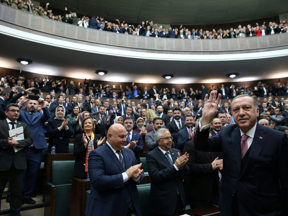 Turkish President Tayyip Erdogan greets members of parliament from his ruling AK Party (AKP) during a meeting at the Turkish parliament in Ankara, Turkey, February 20, 2018. Photo: Presidential Palace/Handout via Reuters