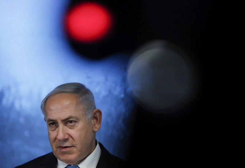 FILE PHOTO: Israeli Prime Minister Benjamin Netanyahu delivers a speech during an event marking the International Holocaust Victims Remembrance Day and the 75th anniversary of the breakthrough the Nazi Siege of Leningrad in the World War II, at the Jewish Museum and Tolerance Centre in Moscow, Russia January 29, 2018. REUTERS/Maxim Shemetov/File Photo