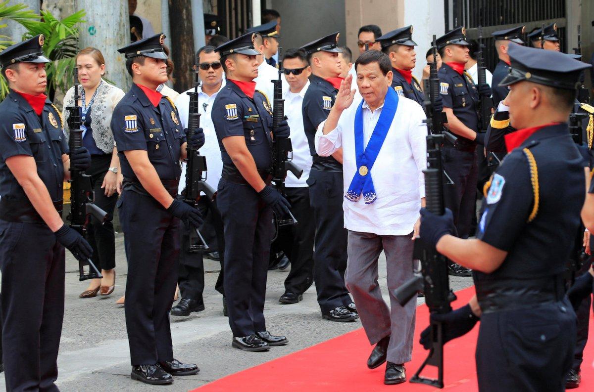 Philippine President Rodrigo Duterte salutes police in Metro Manila on February 6, 2018. Reuters/Romeo Ranoco
