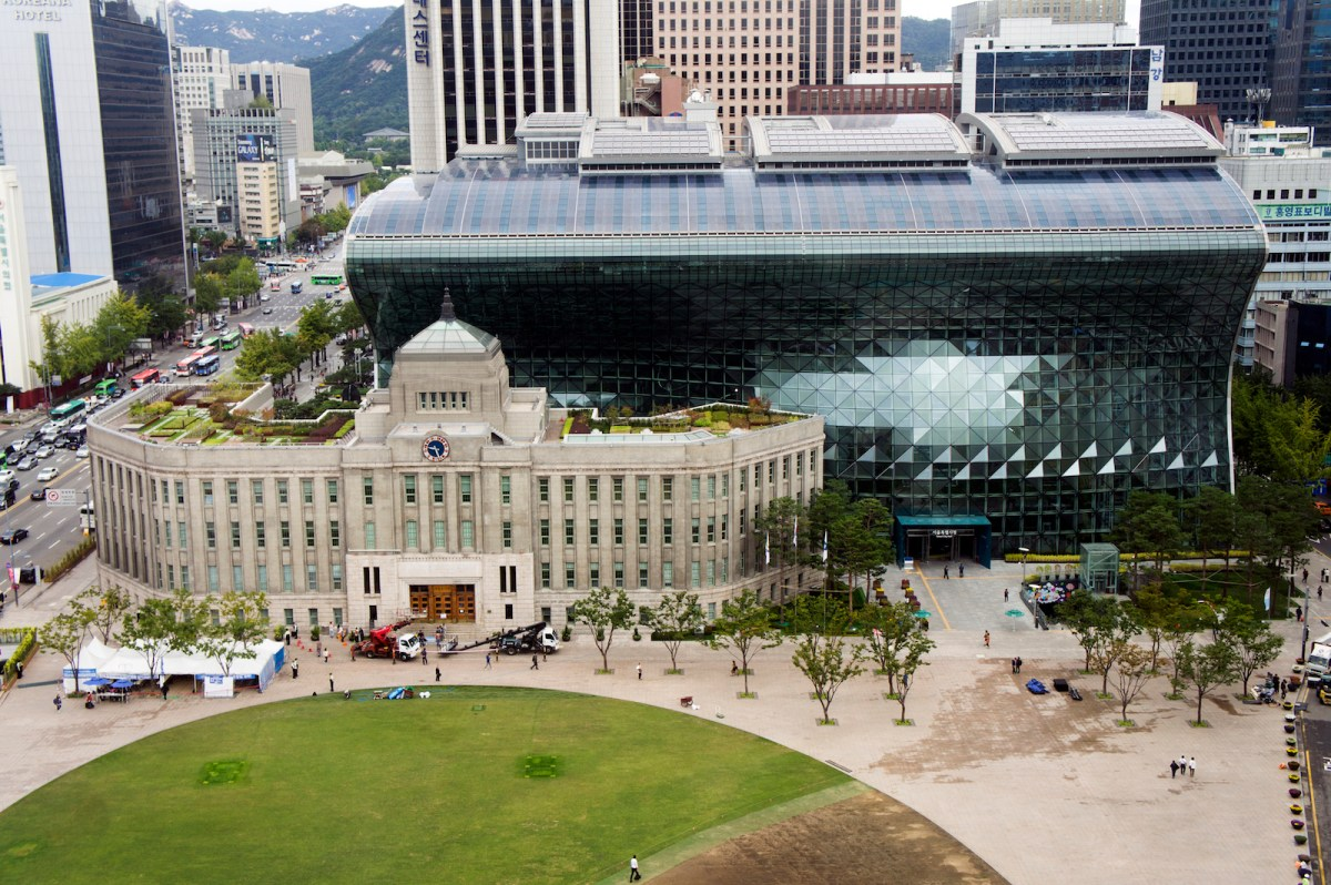 The old City Hall building in front of the new City Hall building in Seoul. The green field in the foreground is Seoul Plaza, a popular gathering spot and venue for numerous events and festivals. Photo: iStock