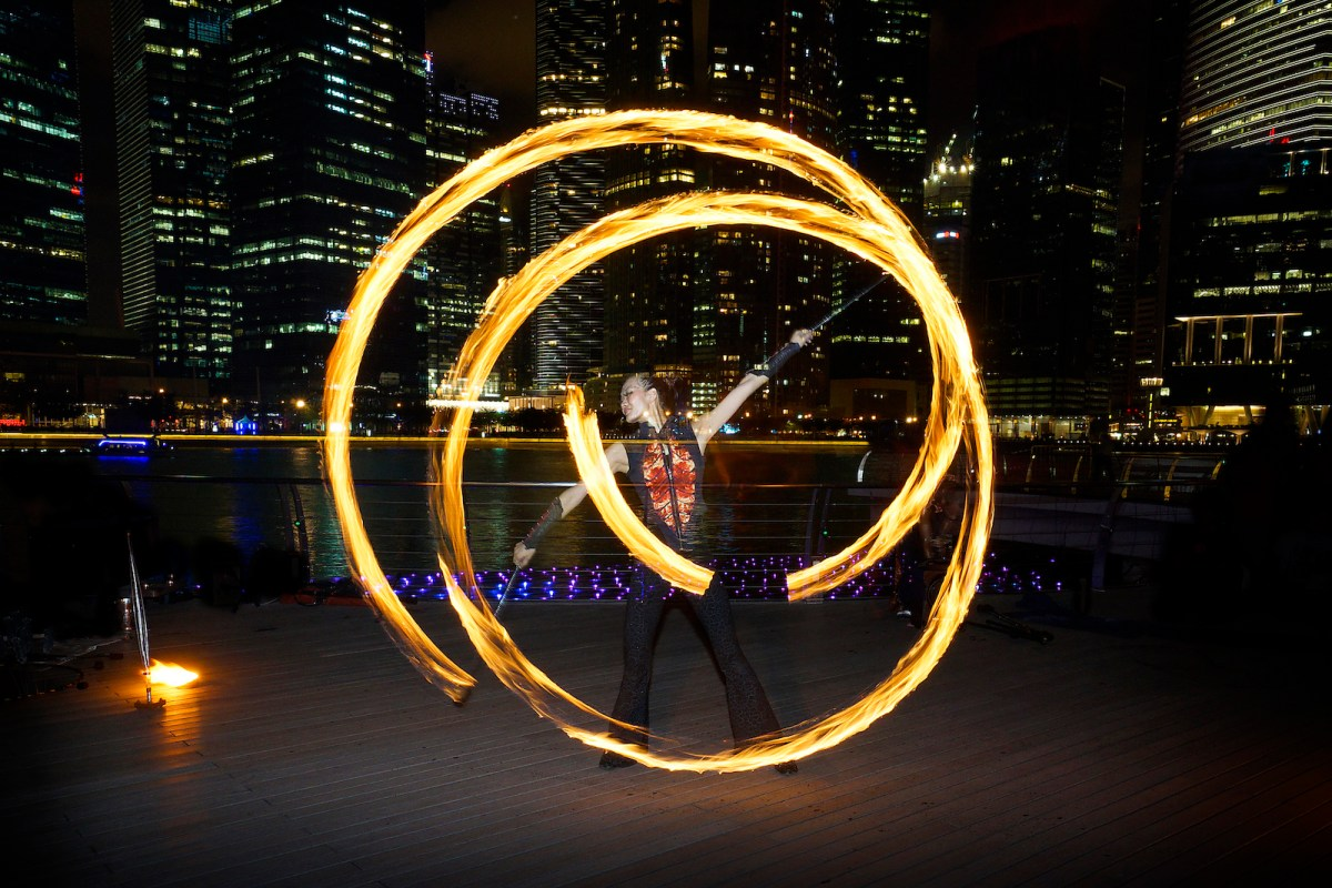 A fire dancer street art performance at Marina Bay, Singapore. Photo: iStock/Getty Images