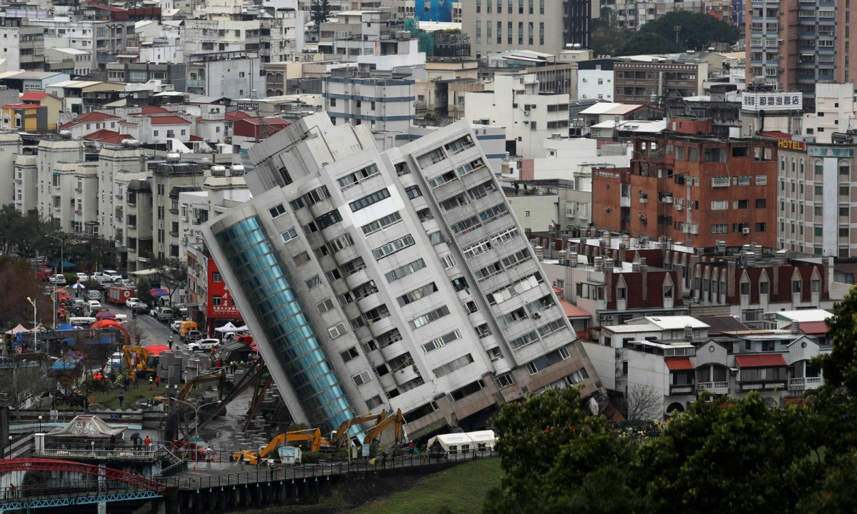 The damaged building is seen after an earthquake hit Hualien, Taiwan on February 8, 2018. REUTERS/Tyrone Siu