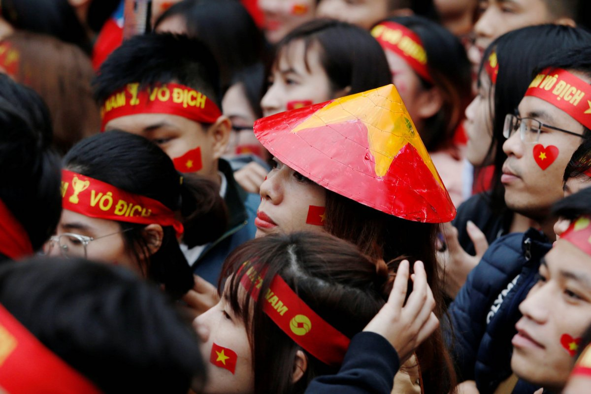 Vietnamese wear nationalistic garbs while watching a football game in Hanoi, Vietnam January 27, 2018. Photo: Reuters/Kham