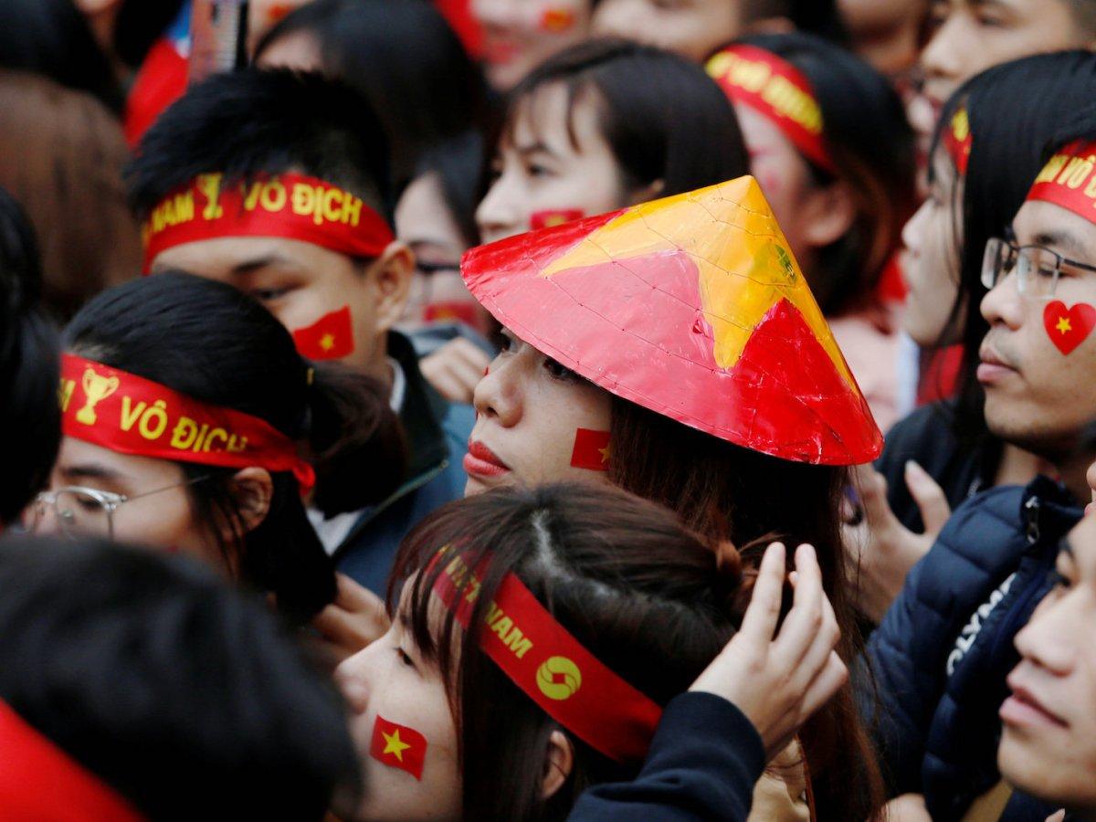 Vietnamese wear nationalistic garbs while watching a football game in Hanoi, Vietnam January 27, 2018. Photo: Reuters/Kham