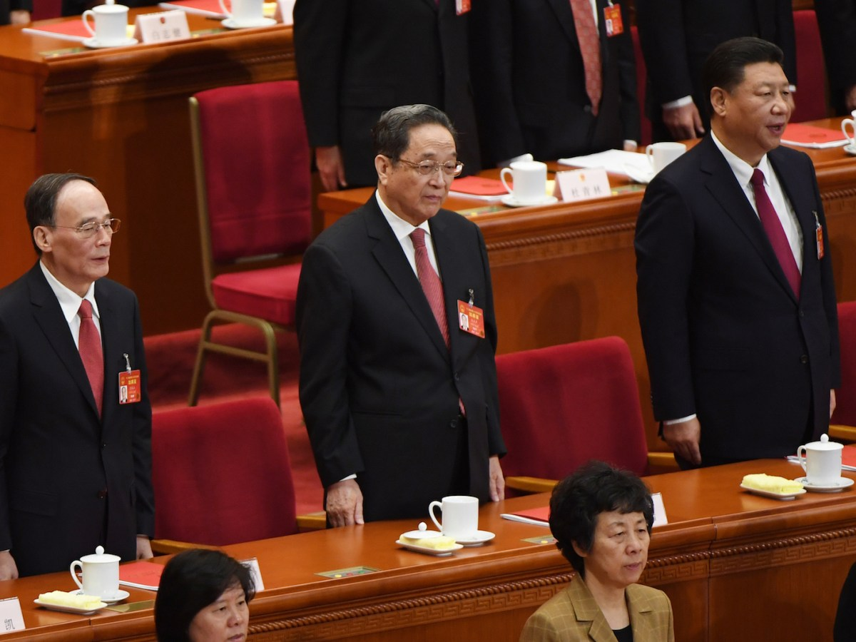 Wang Qishan (left) with Yu Zhengsheng (center), the chairman of the National Committee of the Chinese People's Political Consultative Conference, and President Xi Jinping at the National People's Congress in the Great Hall of the People in Beijing. Photo: AFP / Greg Baker