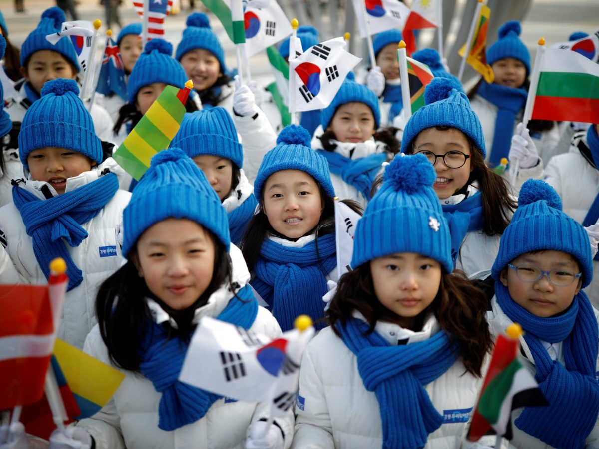 Children cheer during the Olympic torch relay in Gangneung, South Korea on February 8, 2018.   Photo: Reuters/Kim Hong-Ji