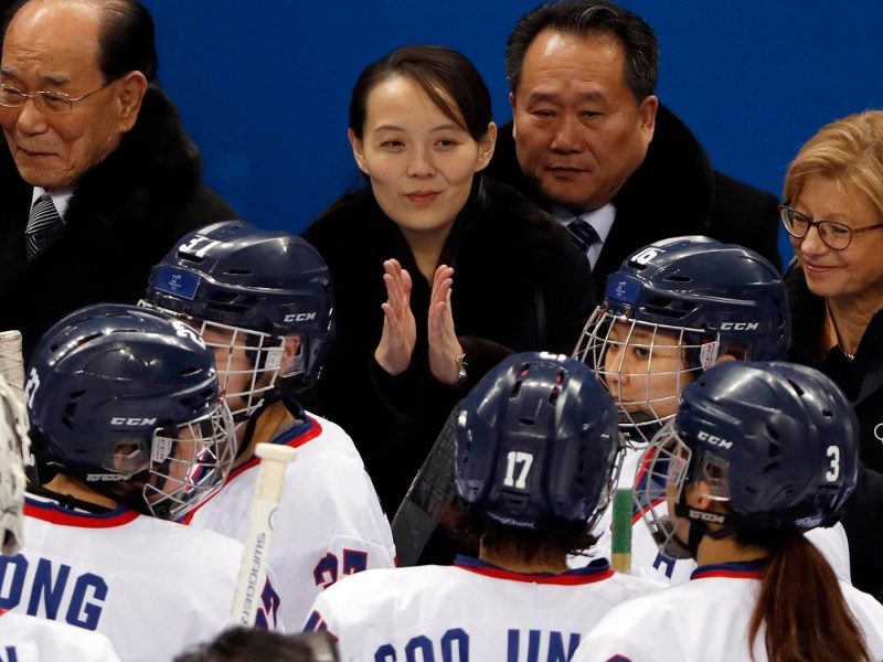 North Korean leader Kim Jong-un's sister, Kim Yo-jong, speaks with the joint Korean Women's ice hockey team after their first game of the Olympics against Switzerland on Feb. 10, 2018. Next to her is Kim Yong-nam. Photo: Reuters/Grigory Dukor