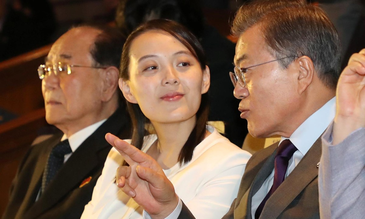 South Korean President Moon Jae-in talks with Kim Yo-jong, the sister of North Korea's leader Kim Jong-un, while watching North Korea's Samjiyon Orchestra's perform on February 11, 2018.   Photo: Yonhap via Reuters