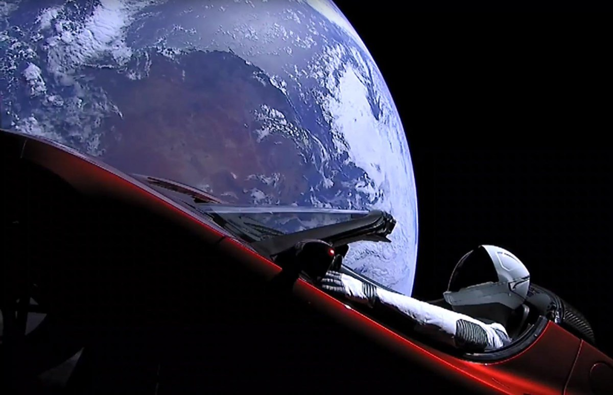 A dummy named 'Starman' sits in SpaceX CEO Elon Musk's cherry red Tesla roadster after the Falcon Heavy rocket delivered it into orbit around the Earth on February 6, 2018. Photo: SpaceX