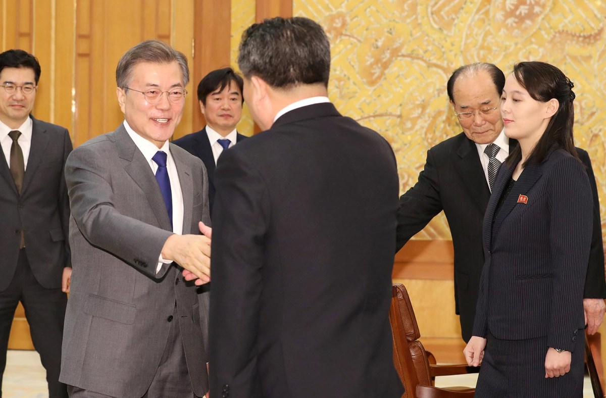 South Korean President Moon Jae-in shakes hands with Ri Son-kwon, chairman of the Committee for the Peaceful Reunification of the Fatherland, last February. Photo: Yonhap via Reuters