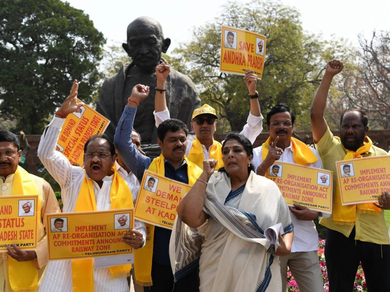 Telgu Desham Party MPs shout slogans demanding special status for the state of Andhra Pradesh during a protest outside Parliament in New Delhi on March 19, 2018.  Photo: AFP / Prakash Singh