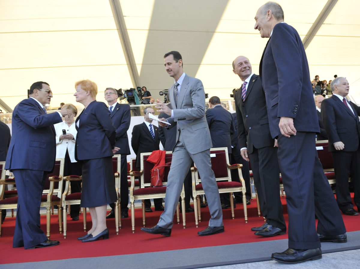 Syrian President Bashar Al-Assad and then Israeli Prime minister Ehud Olmert attend Bastille Day celebrations in Paris on July 14, 2008. Photo: AFP / ERIC Feferberg