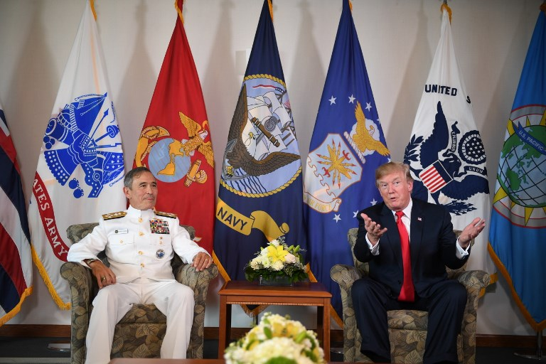 US President Donald Trump meets with Admiral Harry Harris, Commander, US Pacific Command. Photo: AFP/Jim Watson