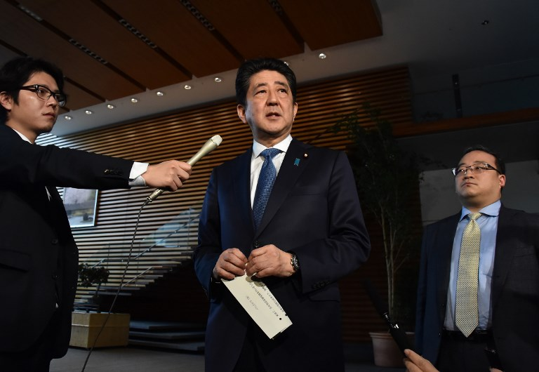 Japan's PM Shinzo Abe talks to media after speaking with his US counterpart about meeting in early April. Photo: The Yomiuri Shimbun via AFP