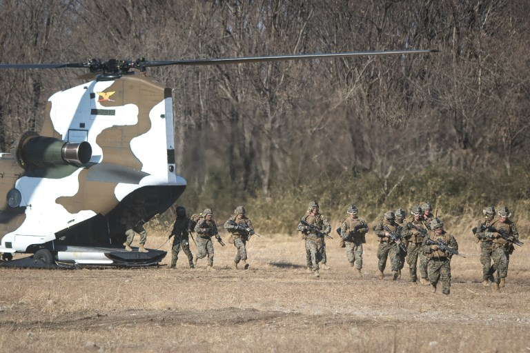 Japan's Ground Self Defense Force and the US Marines take part in a training exercise. Photo: Anadolu Agency via AFP/Richard Atrero de Guzman