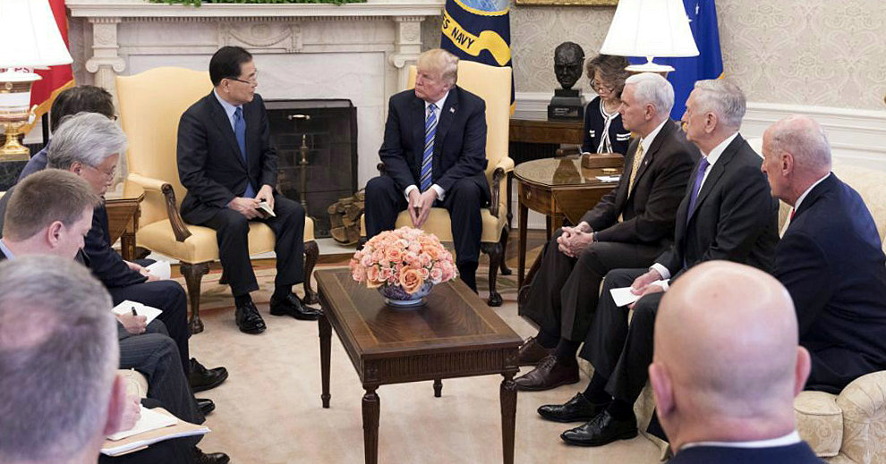 South Korea's national security chief, Chung Eui-yong, briefs US President Donald Trump at the Oval Office about his visit to North Korea, in Washington on March 8. Photo: Presidential Blue House / Yonhap via Reuters