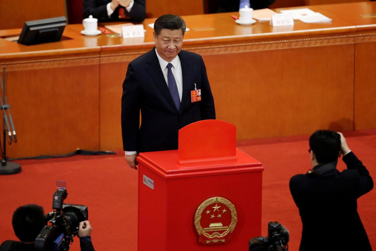 Chinese President Xi Jinping looks on after dropping his ballot during a vote on a constitutional amendment lifting presidential term limits, at the third plenary session of the National People's Congress (NPC) at the Great Hall of the People in Beijing, China, on March 11, 2018. Photo: Reuters / Jason Lee