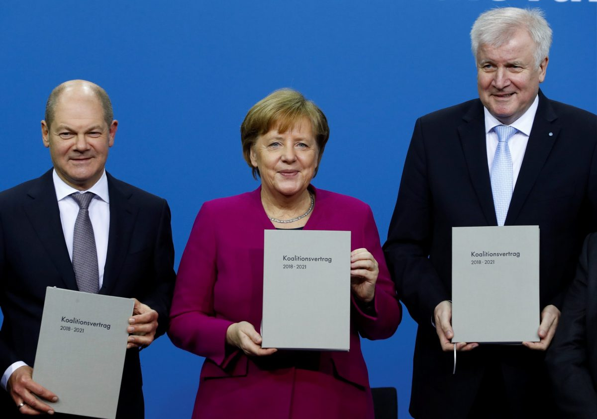 German Chancellor Angela Merkel flanked by leaders of her party's grand coalition partners. Photo: Reuters/Fabrizio Bensch