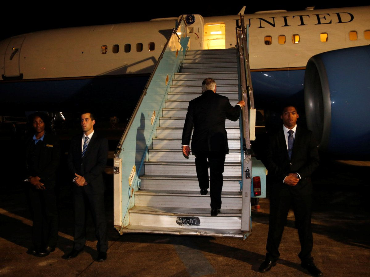 Rex Tillerson boards his plane at the end of a five-country swing through Africa that turned out to be his swansong as US secretary of state. Photo: Reuters / Jonathan Ernst