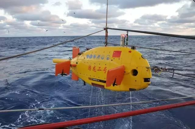 The chubby, fish-like Qianlong-2 submersible is lowered from its mother vessel prior to a dive in the Indian Ocean. Photo: Xinhua