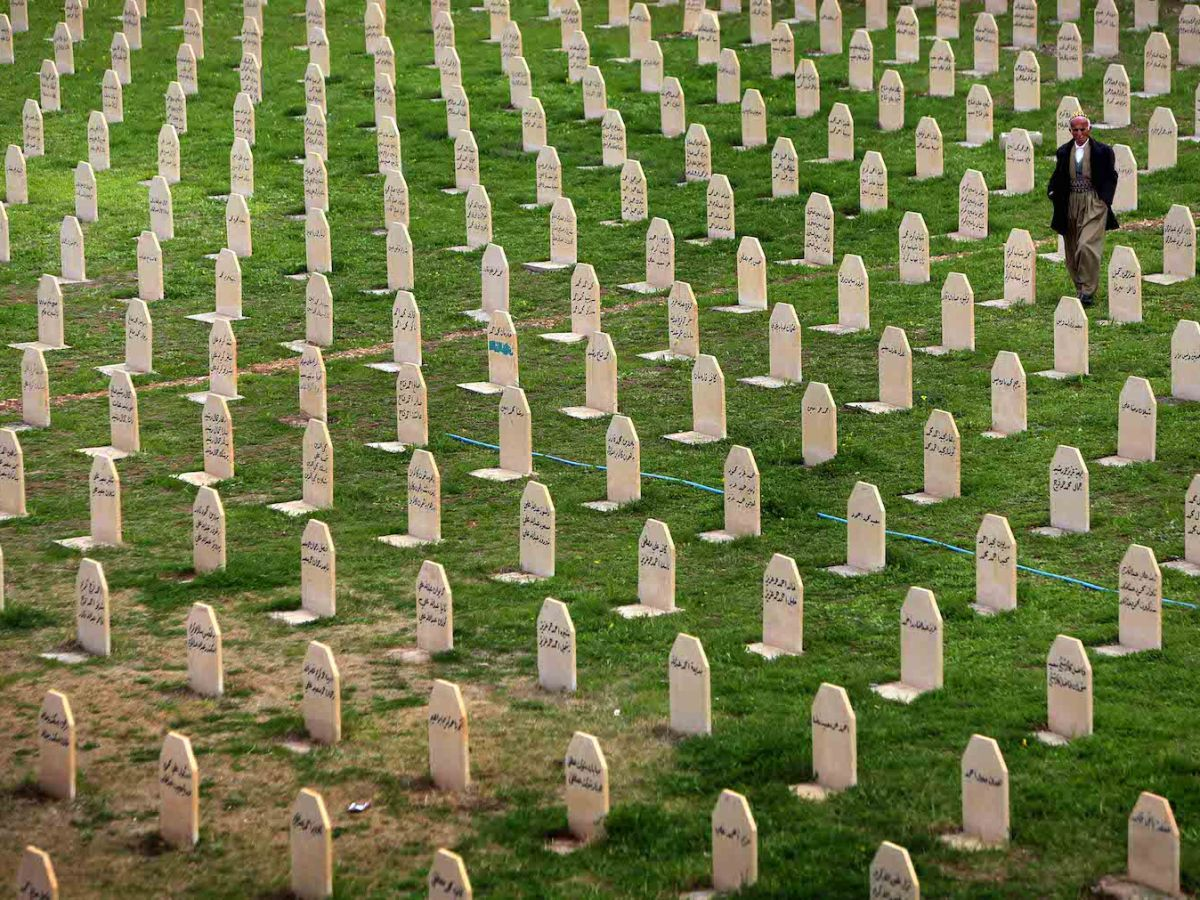 A file photo taken in March 2014 shows an Iraqi Kurd man walking in a graveyard for the victims of a gas attack by former Iraqi president Saddam Hussein in the Kurdish town of Halabja, 300km northeast of Baghdad. Some 2.4 million people are said to have been killed or died since the US invasion in 2003. Photo: AFP / Safin Hamed