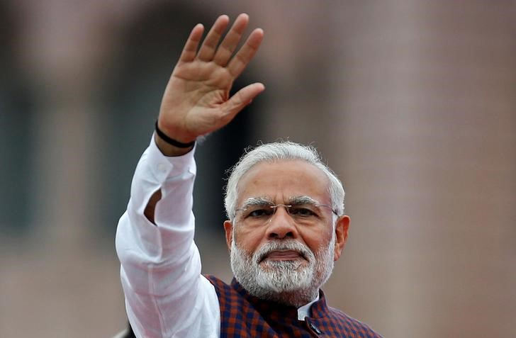 Indian Prime Minister Narendra Modi waves to his supporters as he arrives to address them during an election campaign meeting ahead of Gujarat state assembly elections, in Ahmedabad on December 3, 2017. Photo: Reuters / Amit Dave