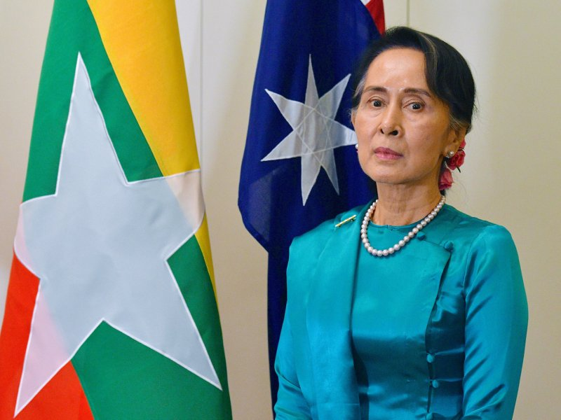 Myanmar's State Counsellor Aung San Suu Kyi stands next to national flags of Australia and Myanmar at Parliament House in Canberra, Australia, March 19, 2018.    Photo: AAP via Reuters/Mick Tsikas