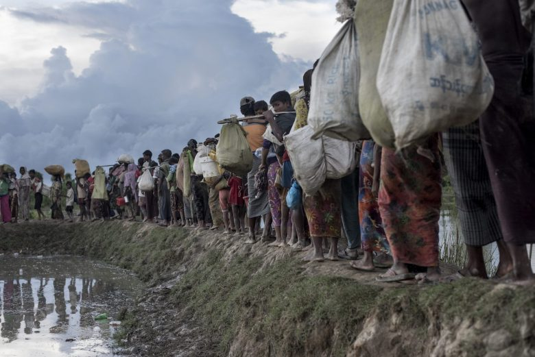 Rohingya refugees walk after crossing the Naf river from Myanmar into Bangladesh in Whaikhyang.Photo: AFP/Fred Dufour