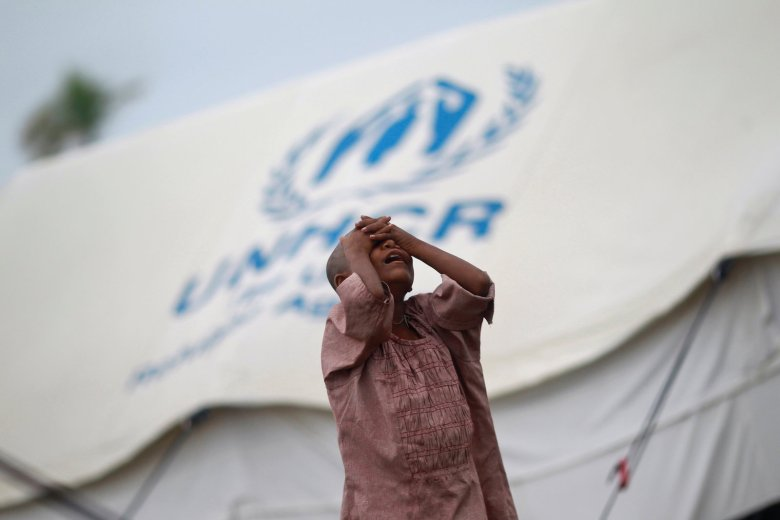 A Rohingya girl grieves outside of a UNHCR tent in Bangladesh in a file photo. Photo: Reuters/Soe Zeya Tun Photo