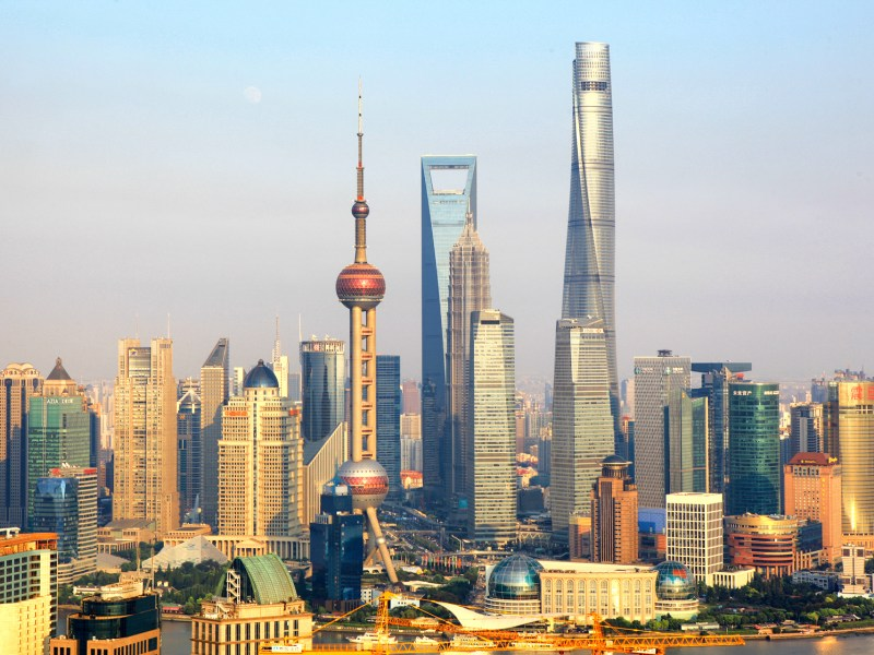The Shanghai Tower (right) with a twist in shape is now the tallest building in China and the second-tallest globally. Photo: Xinhua