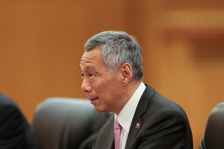 FILE PHOTO: Singapore Prime Minister Lee Hsien Loong attends a meeting with Chinese Premier Li Keqiang (not pictured) at The Great Hall of the People in Beijing, China September 19, 2017. REUTERS/Lintao Zhang/Pool/File Photo