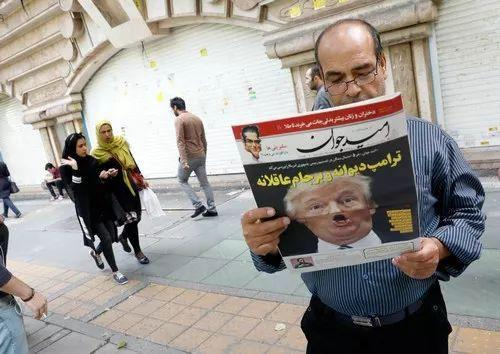 An Iranian reads a newspaper with a front page showing US President Donald Trump. The headline reads 'Trump is a crazy man.' Photo: Reuters