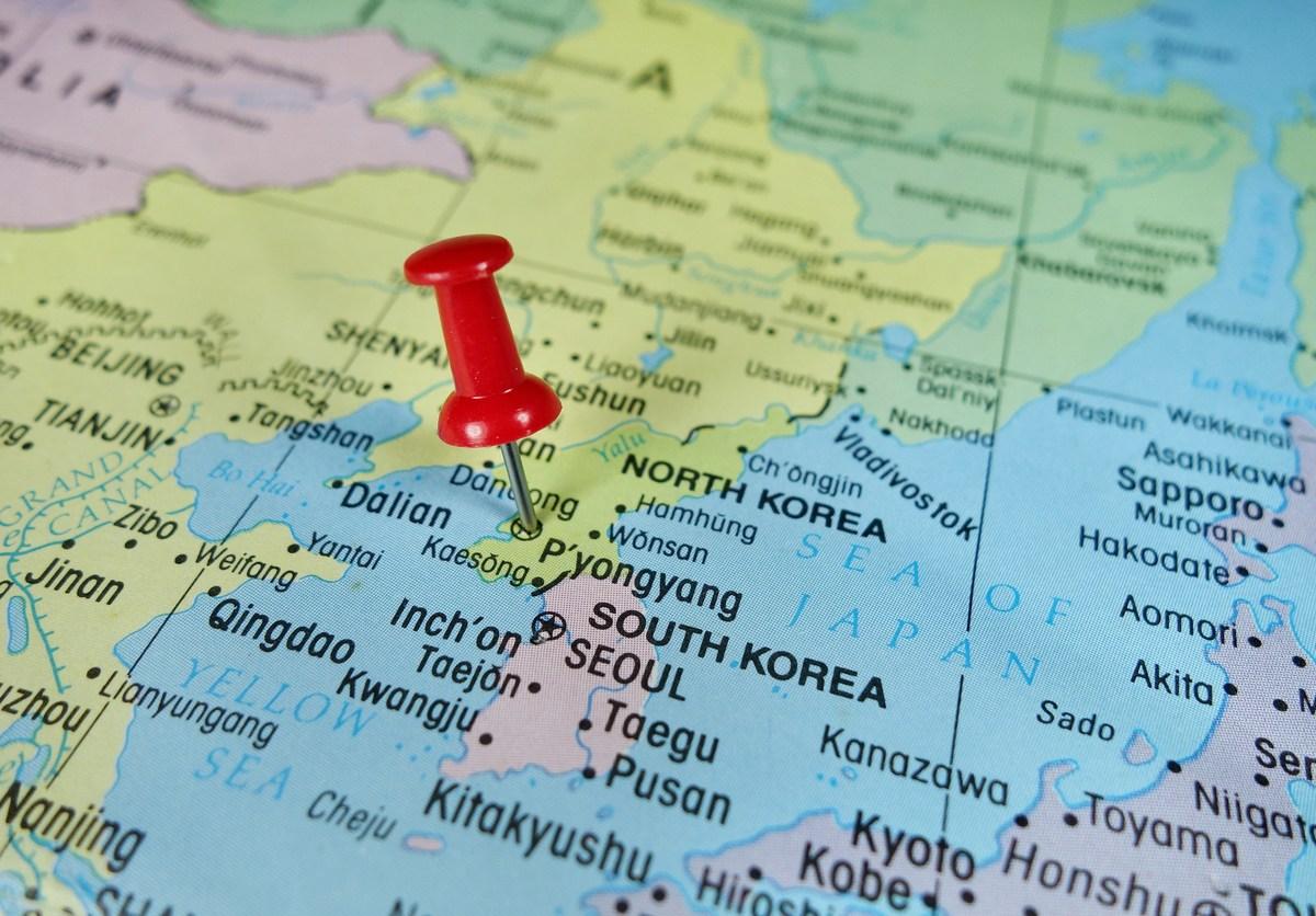 Pushpin marking on Pyongyang, North Korea map. Image: iStock