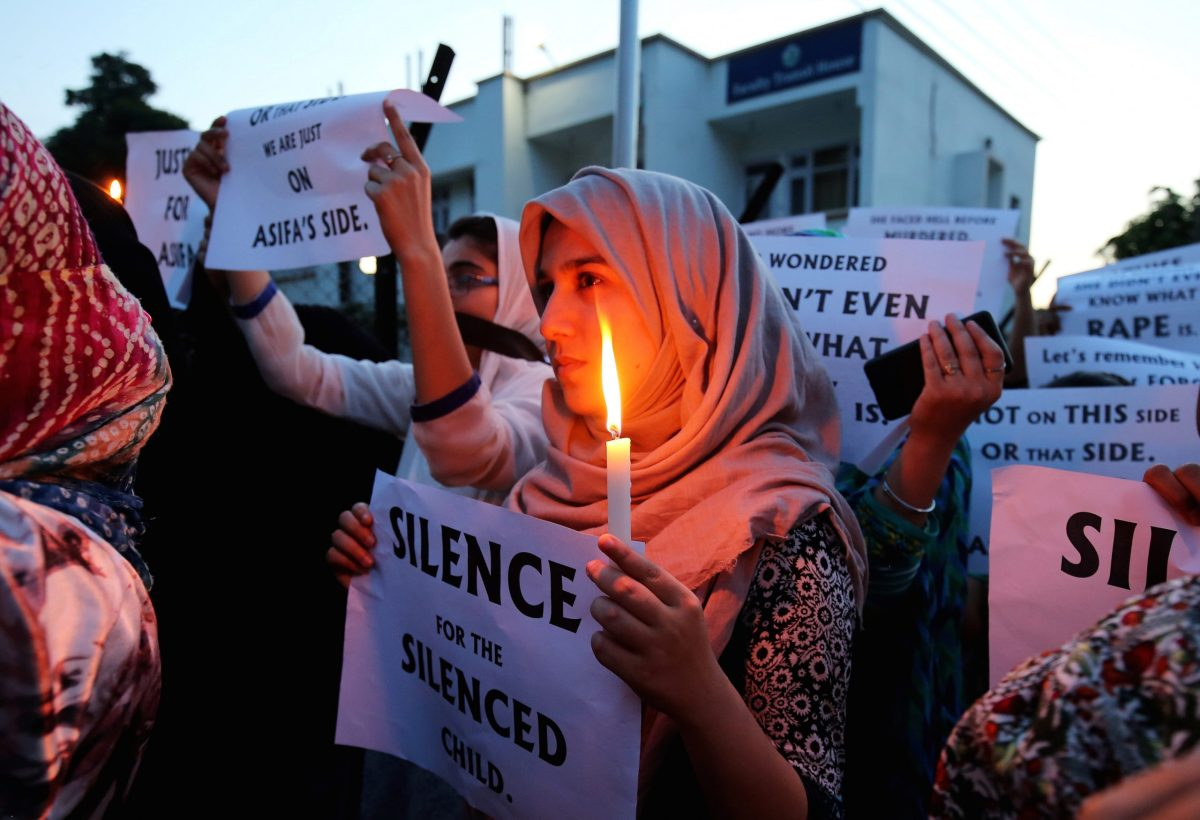 Students take part in a candlelight procession on April 13, 2018, as they protest over the rape and murder of an eight-year-old nomad girl, in Kathua, near Jammu. Photo: Reuters/ Mukesh Gupta