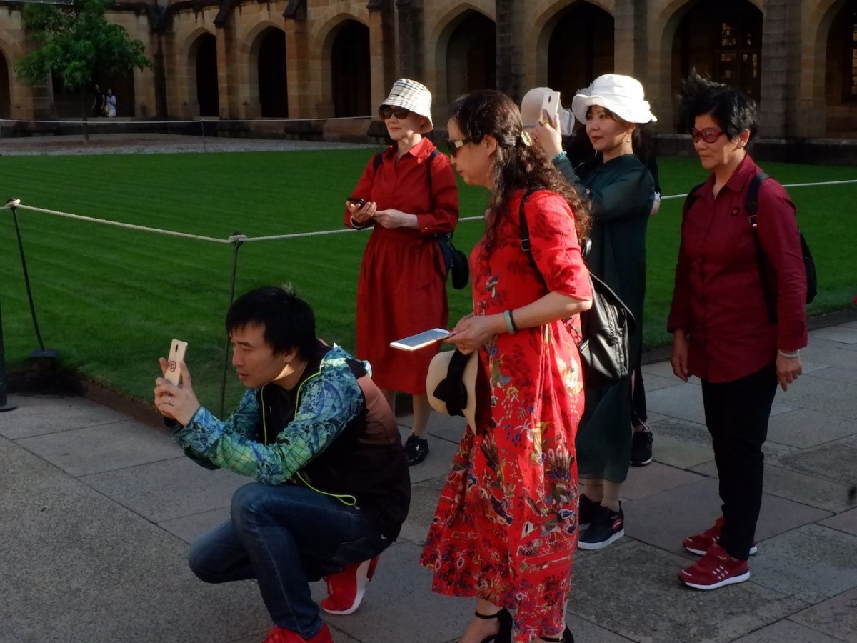 Chinese tourists take pictures at Australia's University of Sydney, April 2018. Photo: Lachlan Colquhoun