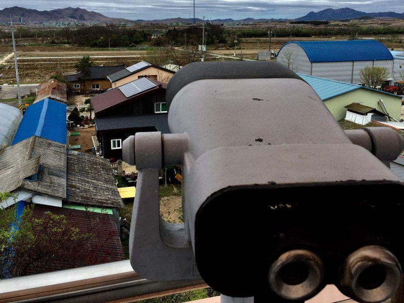 Inside the DMZ, binoculars  on the roof of Daeseong Dong's village hall are aimed at North Korea, just 400 meters distant. Photo: Asia Times/Andrew Salmon
