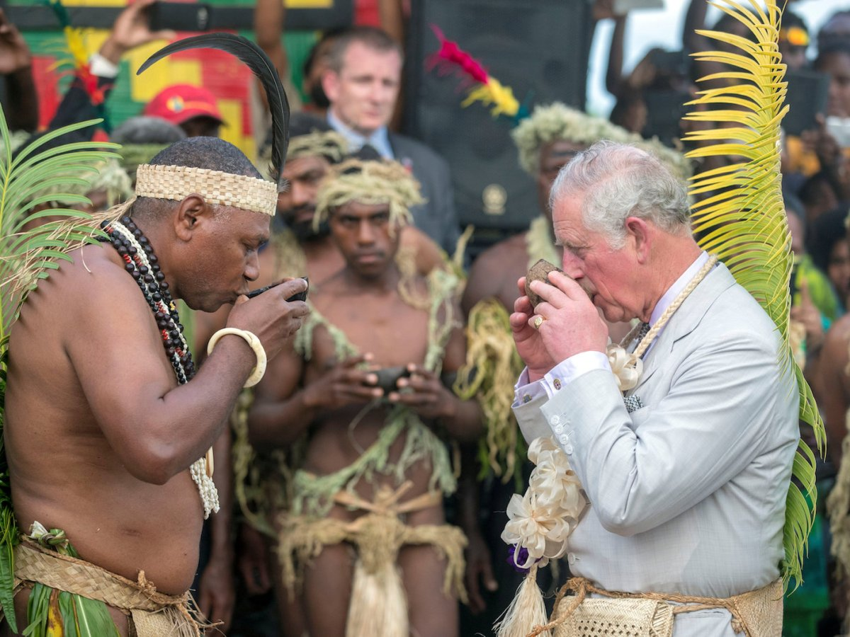 Britain's Prince Charles, takes a drink with Chief Sine Mao Tirsupe, President of the Malvatumauri National Council of Chiefs, during a visit to the Chief's nakamal, as he visits the South Pacific island of Vanuatu,  April 7, 2018. Photo: Pool via Reuters/Steve Parsons